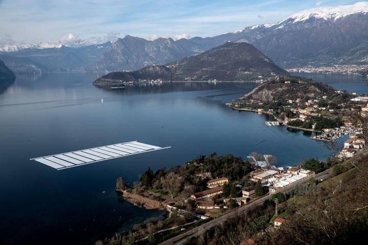 Aerial view of the project's building yard on the Montecolino peninsula (right) and the temporary storage on Lake Iseo (left), February 2016