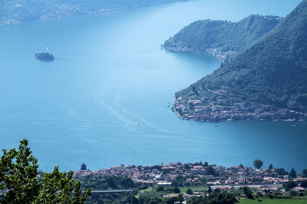 Lake Iseo with the town of Sulzano in the foreground, the island of Monte Isola on the right and the island of San Paolo on the left