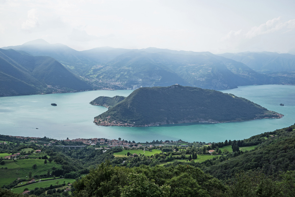 Lake Iseo with the town of Sulzano in the foreground, the island of Monte Isola in the center and the island of San Paolo on the left
