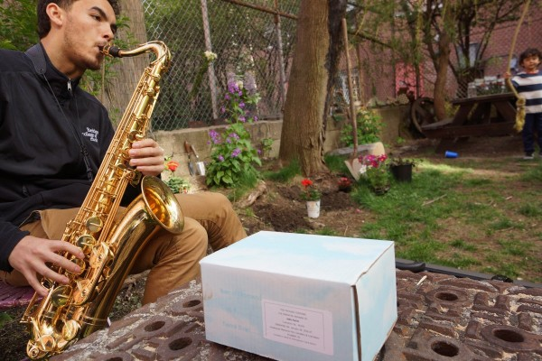 Richard Dye, John Farris's grandson, played sax in the backyard of Bullet Space, where Farris's ashes were scattered. Photos by Sarah Ferguson