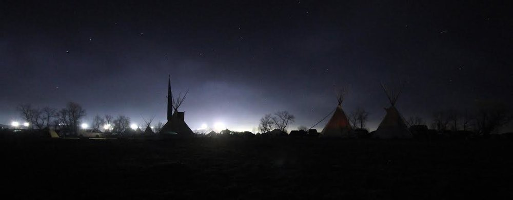 View of the floodlights overlooking the Oceti Sakowin camp at night. Photo by Heather Sioux
