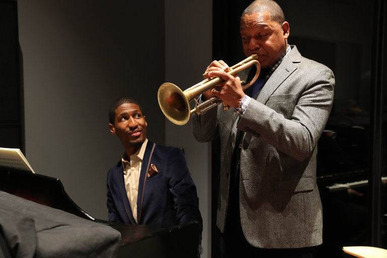 """Jon Batiste, left, and Wynton Marsalis are a crucial part of the album """"The Music of John Lewis,"""" from the Jazz at Lincoln Center Orchestra.CreditMichelle V. Agins/The New York Times"""