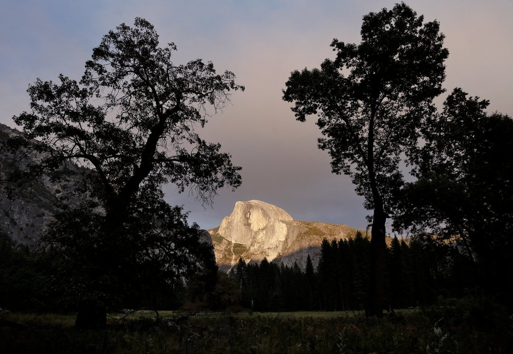 Half Dome at sunset, seen from the Yosemite Valley floor. CreditPreston Gannaway for The New York Times