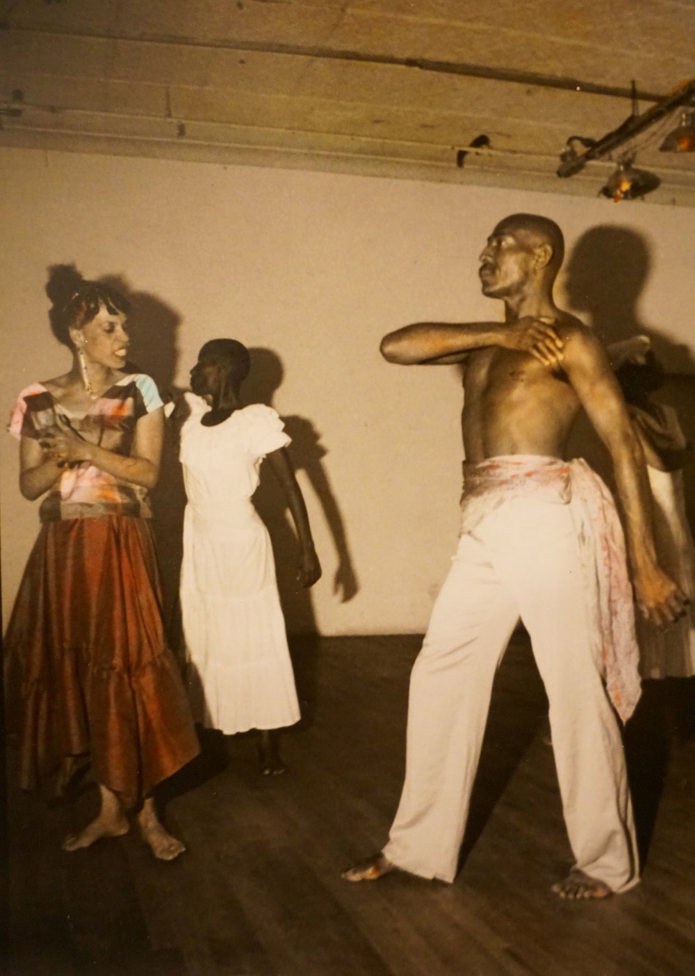 Hand colored B/w Photo taken by Nina Kuo  at Basement Wkshop c 1980's with Jessica Hagedorn and Thulani Davis etc.