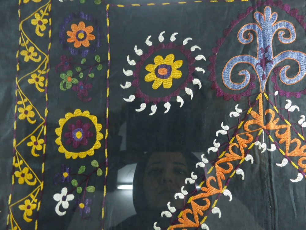 Reflection in a afghan suzani (traditional embroidery) taken at the national museum.