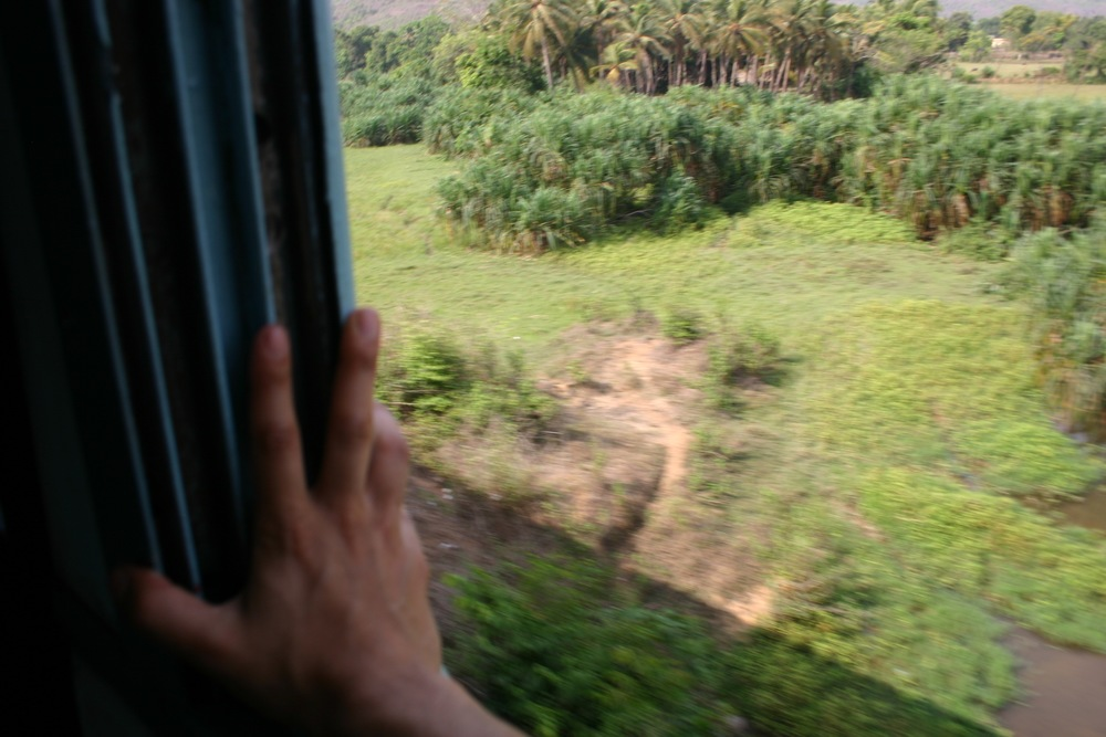 train ride and hand in place.  Somewhere in India
