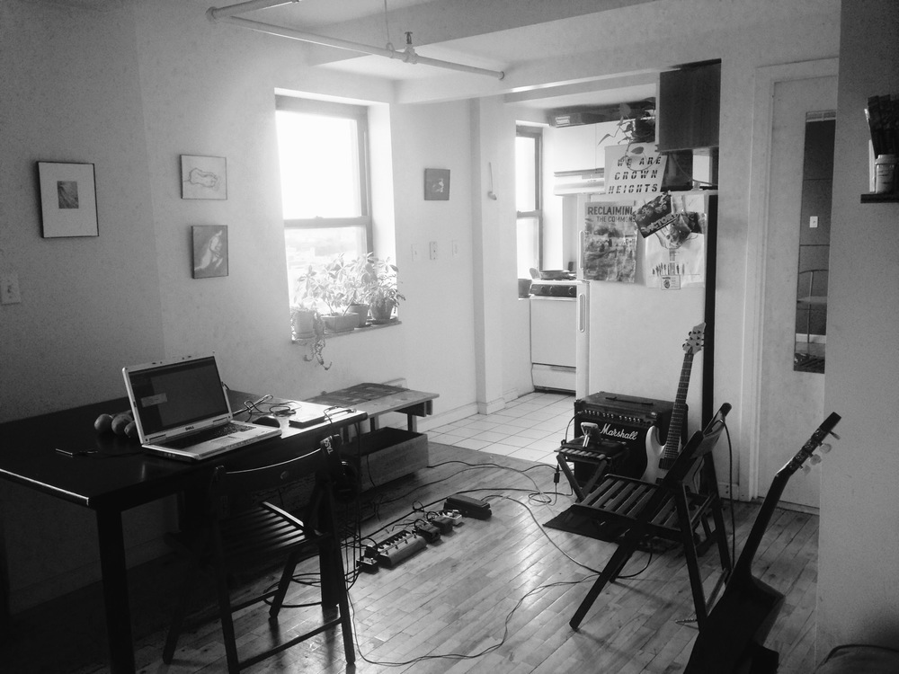 "Here a view of the ""Brooklyn Shuttle Train Studios"" (A.K.A. the living room & kitchen)"