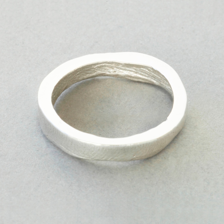 Sterling_Silver_'slender'_buffed_exterior_surface_Patrick_Laing_You_&_Me_wedding_rings.jpg