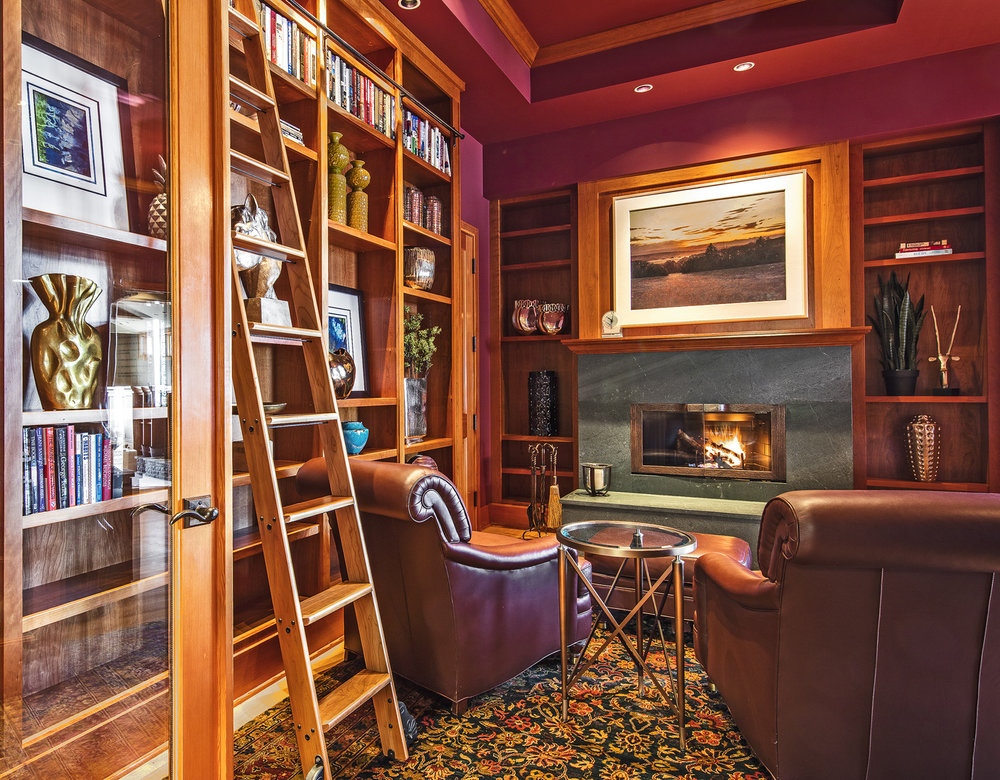Photo of cozy fireplace and in home library study designed by a Seattle Residential Architect