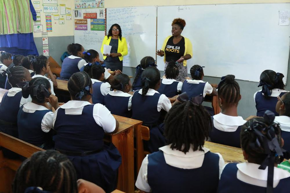 Nicola Reefe (Left) and Charlie Ann St. Cyr (Right) speaking to the Primary School girls, Trinidad  Photo © Curtis Henry