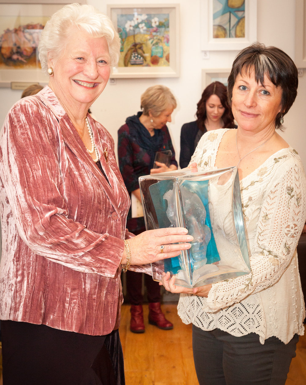 Receiving the Past Presidents award from athlete Dame Mary Peters at the 56th Ulster Women Artists Annual Show in Belfast