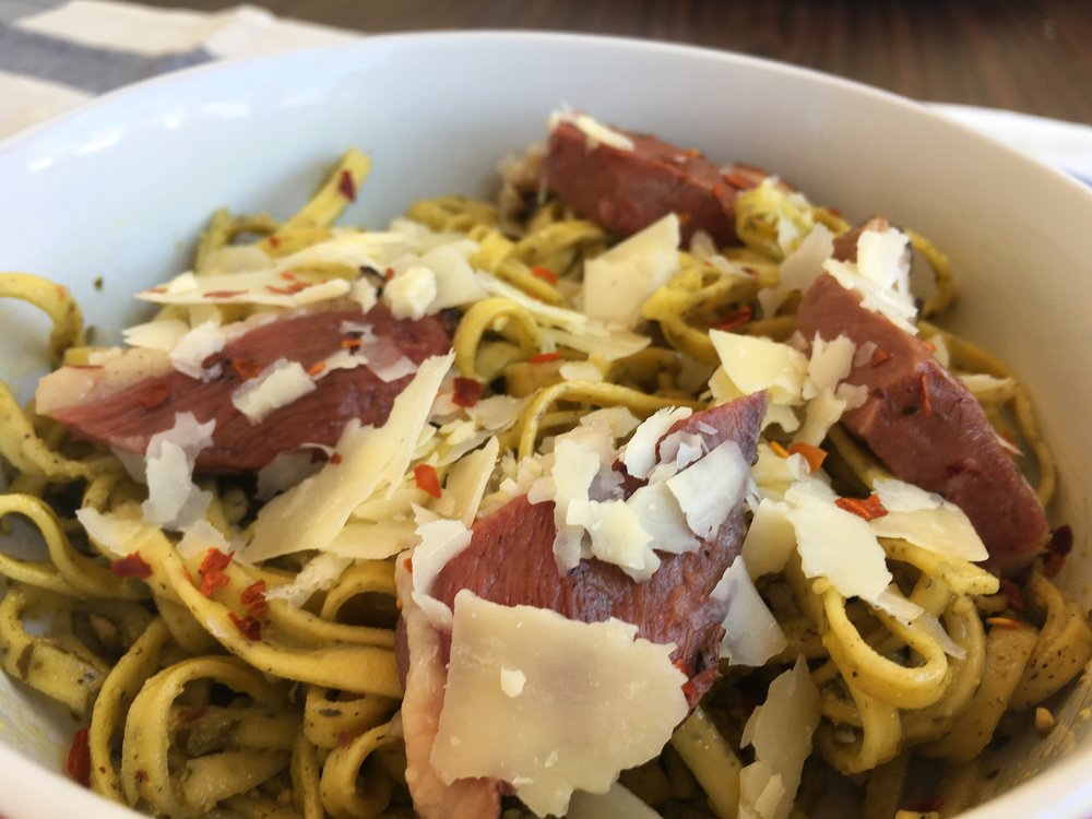 fettuccine with freshly grated parmesan, grilled duck breast, pesto, red pepper flakes and mushrooms.