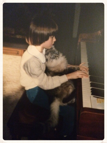 Keeping my eyes on the music (with or without a cat) since I was 5.