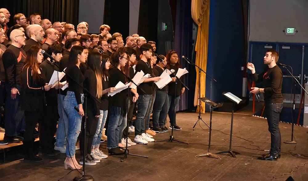 "Students in the South San Francisco High School Choir join SFGMC in singing ""You Have More Friends Than You Know"" during a RHYTHM performance.  Photo: Gareth Gooch"