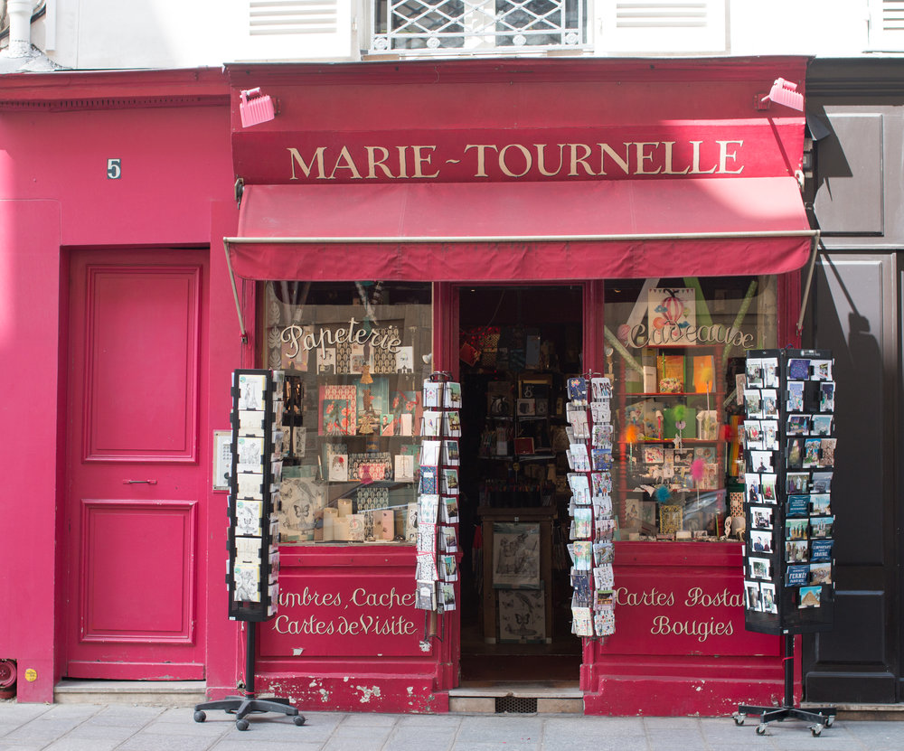 postcards paris red storefront on ile st louis via rebecca plotnick