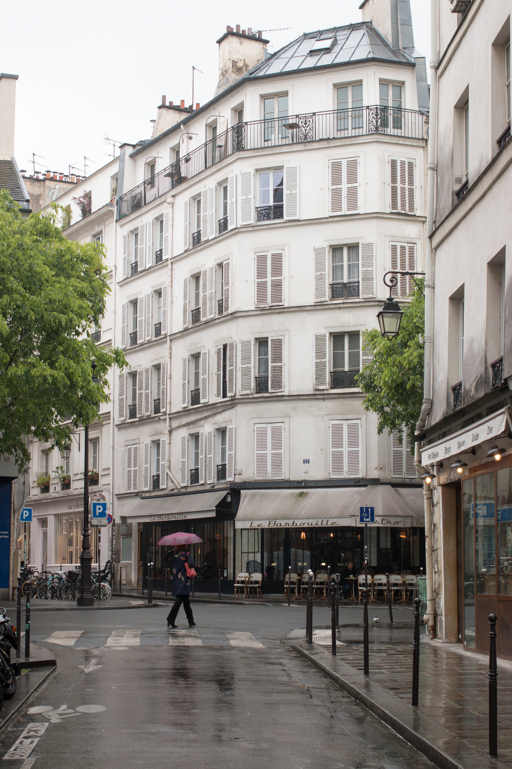 marais paris in the rain by rebecca plotnick