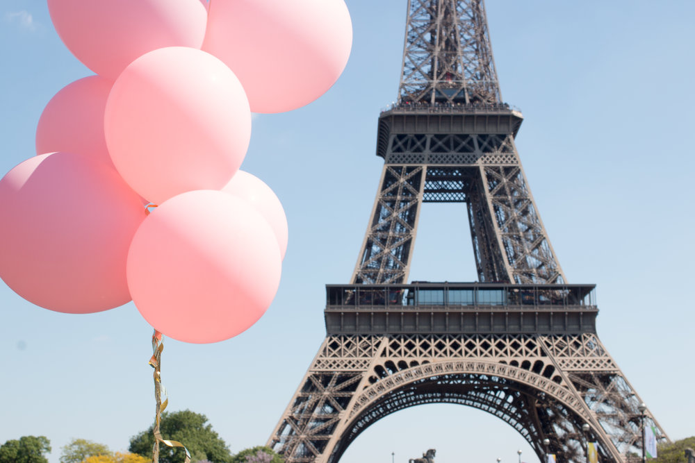 pink balloons in paris france in front of the eiffel tower