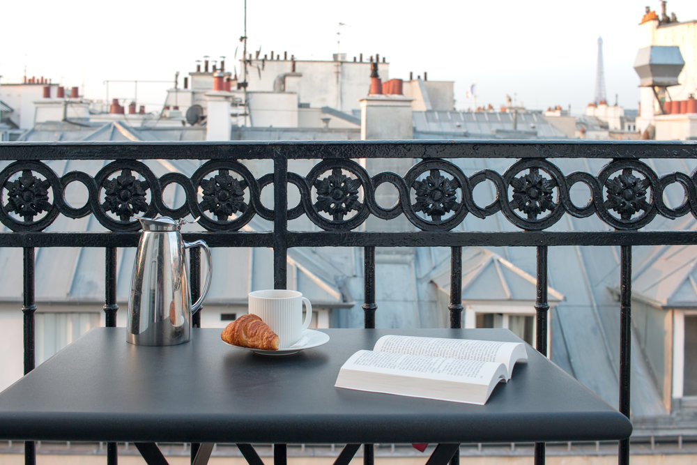 breakfast on the balcony in paris, france at pavillon des lettres