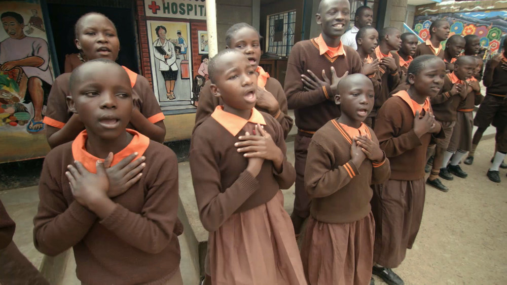 Orphaned children at Magoso Primary School sing each day as part of their instruction. The school is located in the heart of Kibera, Africa's largest urban slum.