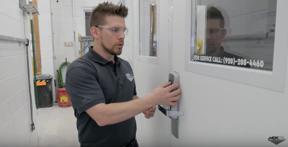 Adam using the programmable entryway lock to get in the onsite system