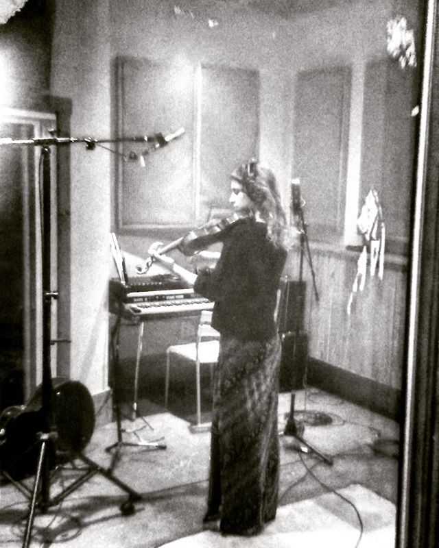 Kendra laying down 🎻  #recording @codapopstudios
