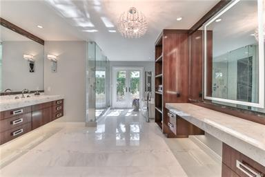 The Home boasts 5 Beds, 7 Baths, features about 6,000 SF of living space, and was completely renovated in 2017. Pretty rare to see a home this modern behind the gates. It sold rather quickly.