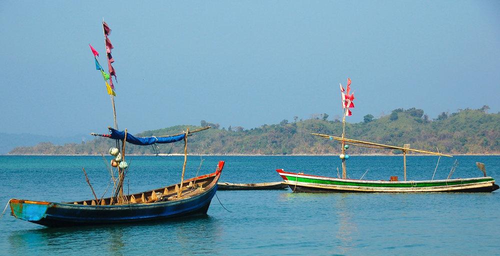 Wooden fishing boats at anchor near Ngapali, Myanmar