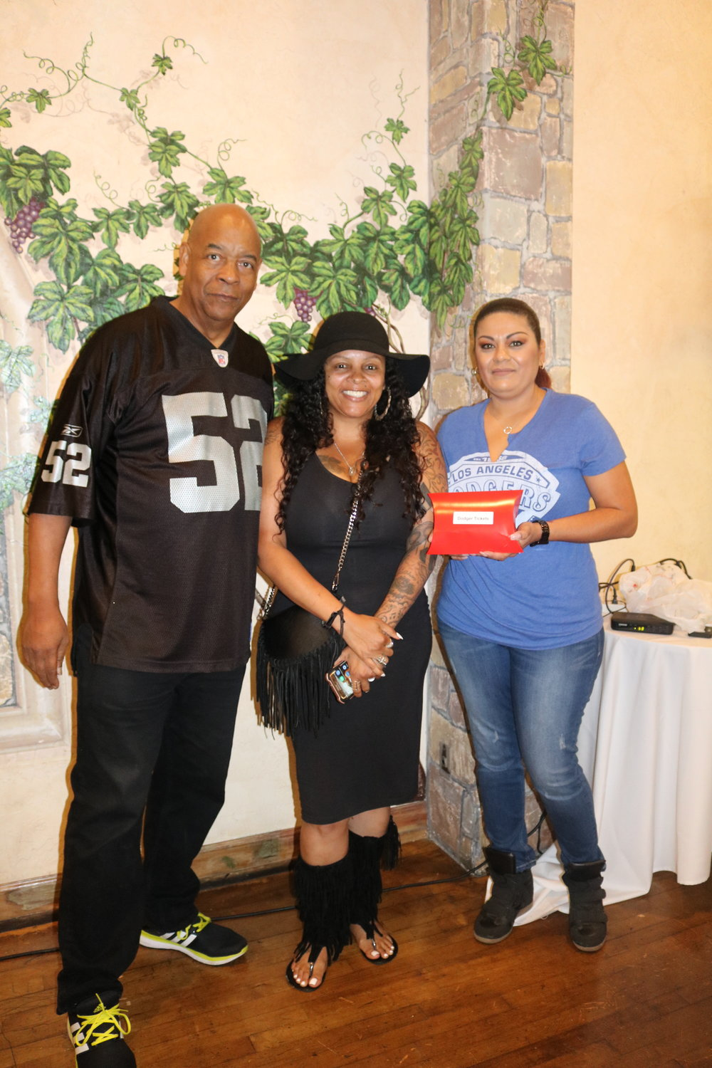 This year's event had a sports theme. Attendees received raffle tickets for sports-related prizes including tickets to a Dodger game.
