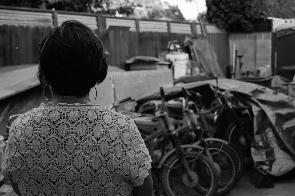 Joyce overlooking her husbands collection of motorcycles. Before she began selling them after his death,the collection totaled 20.