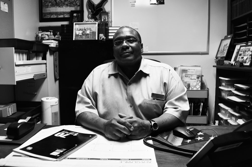 Lenford sits proudly in his office at the Long Beach Rescue Mission.