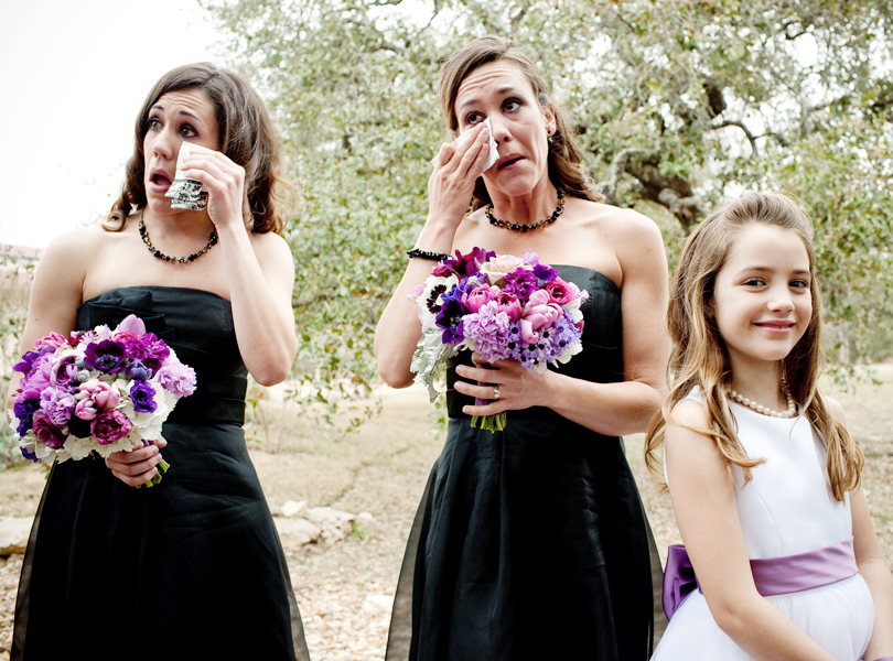 crying bridesmaids and smiling flower girl