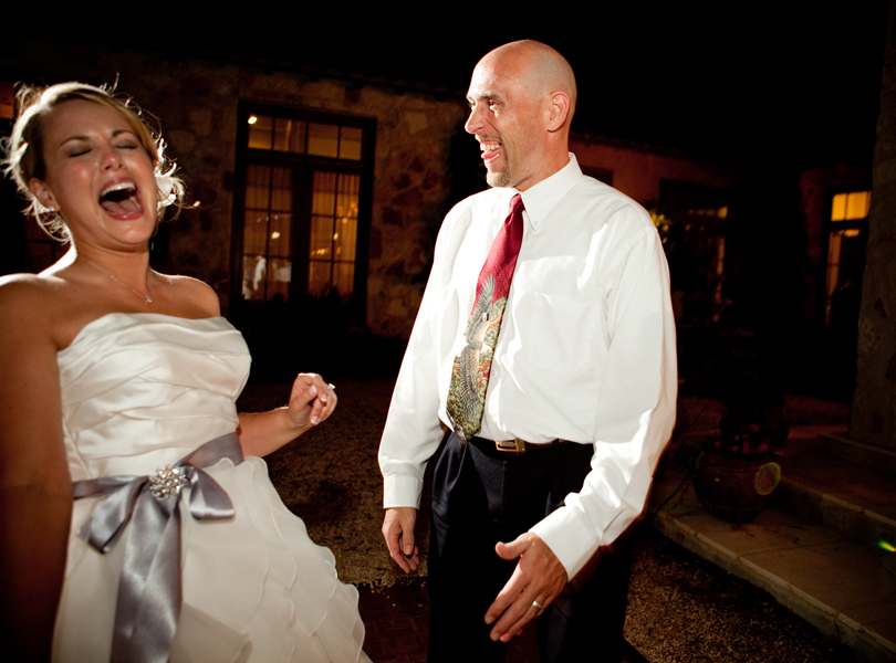 bride laughing with brother on the dance floor, wedding pictures