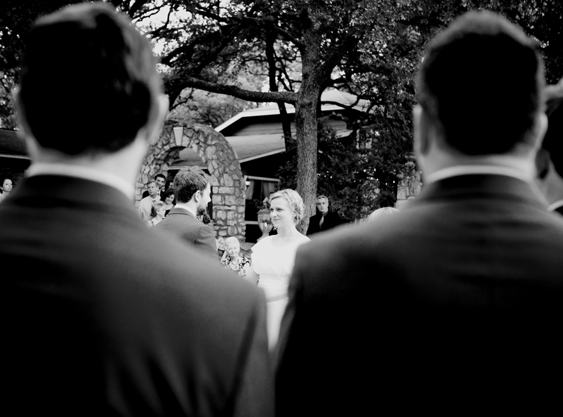 creative view of bride and groom at the alter houston wedding photography