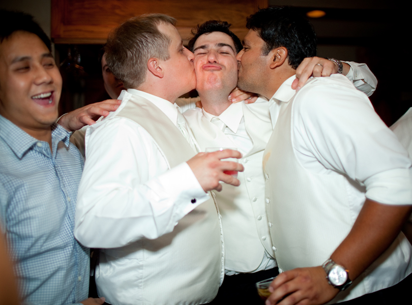 groom kisses, The Hills Country Club Wedding, shots at the bar