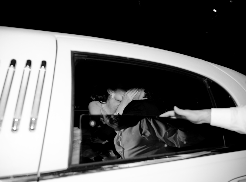 bride and groom kiss, black and white, limo, The Hills Country Club Wedding