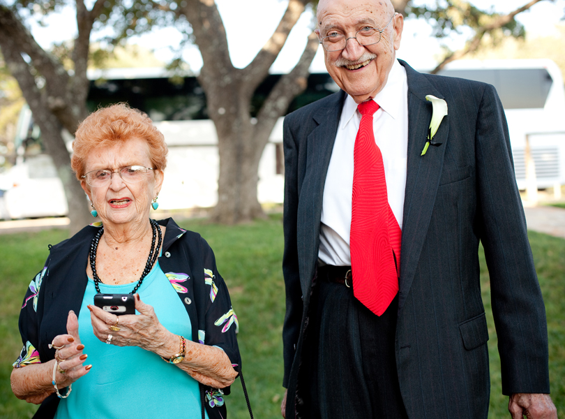 grandparents, smart phone, red tie