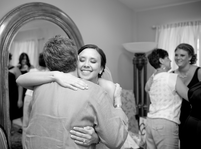 bride hugging, thurman mansion wedding