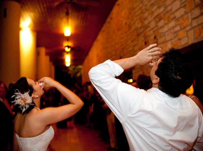 bride and groom taking shots, thurman mansion wedding