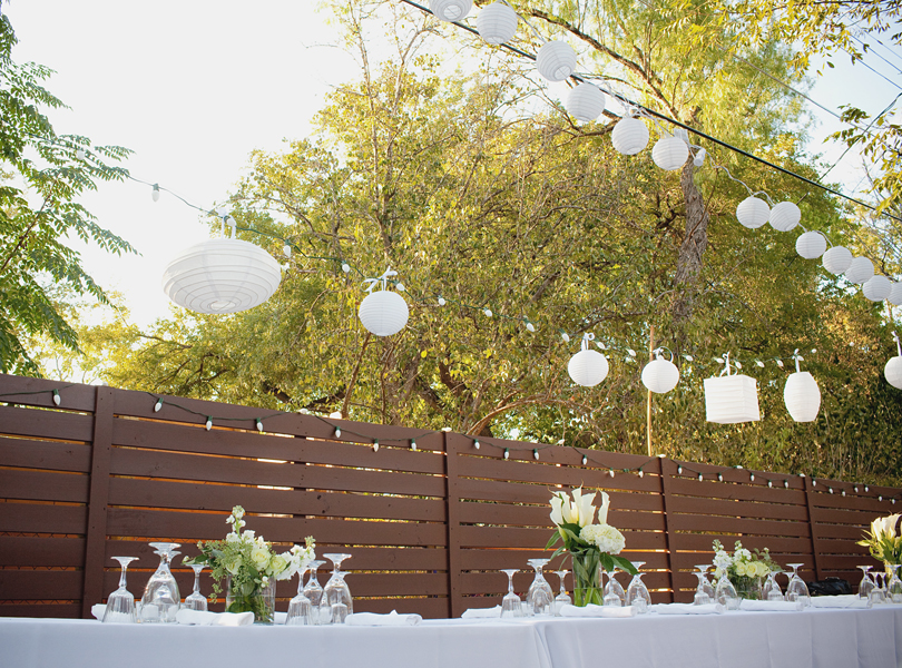 charming south austin backyard wedding, whole foods, DIY, austin wedding photographer, table setting, fence, sunset