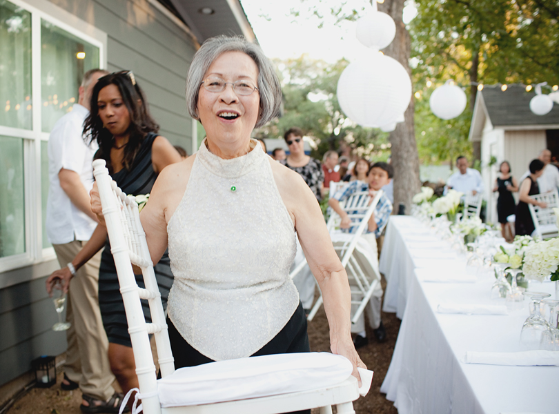 charming south austin backyard wedding, whole foods, DIY, mother of the bride, carrying a chair, flipping the wedding,