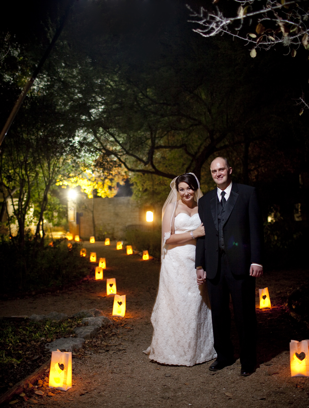 low light wedding photography, Austin wedding photographer, wedding dress, unbridaled, lady bird johnson wildflower center, wedding dress, tuxedo, wedding weil, bride and groom