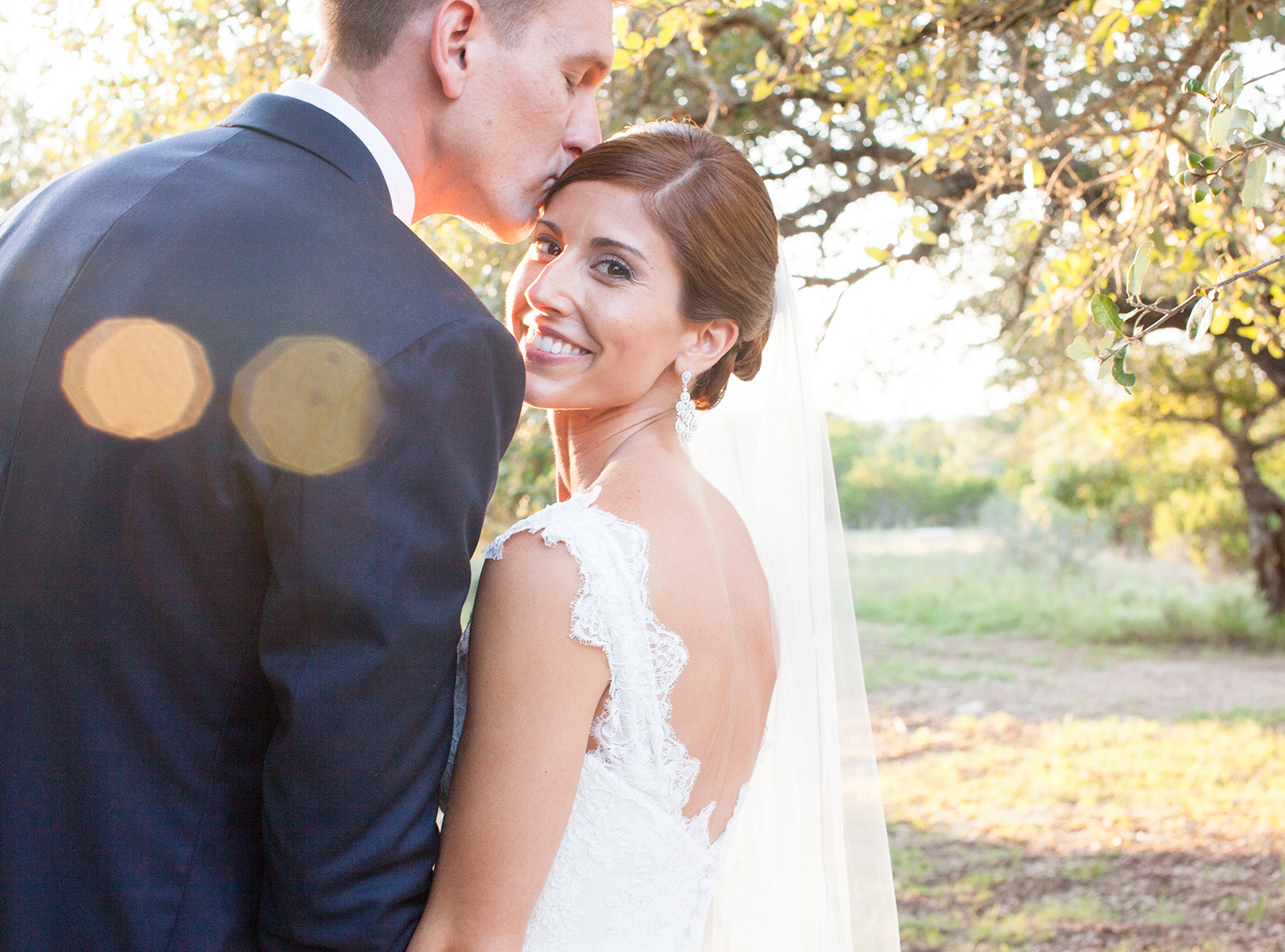 Vista West Ranch Wedding Photography, Dripping Springs Wedding Photography, Austin Weddings, Coordinate This, lacy bridal gown, backless wedding dress, bride and groom posing together in the setting sunlight, peaceful, Outdoor wedding, nature