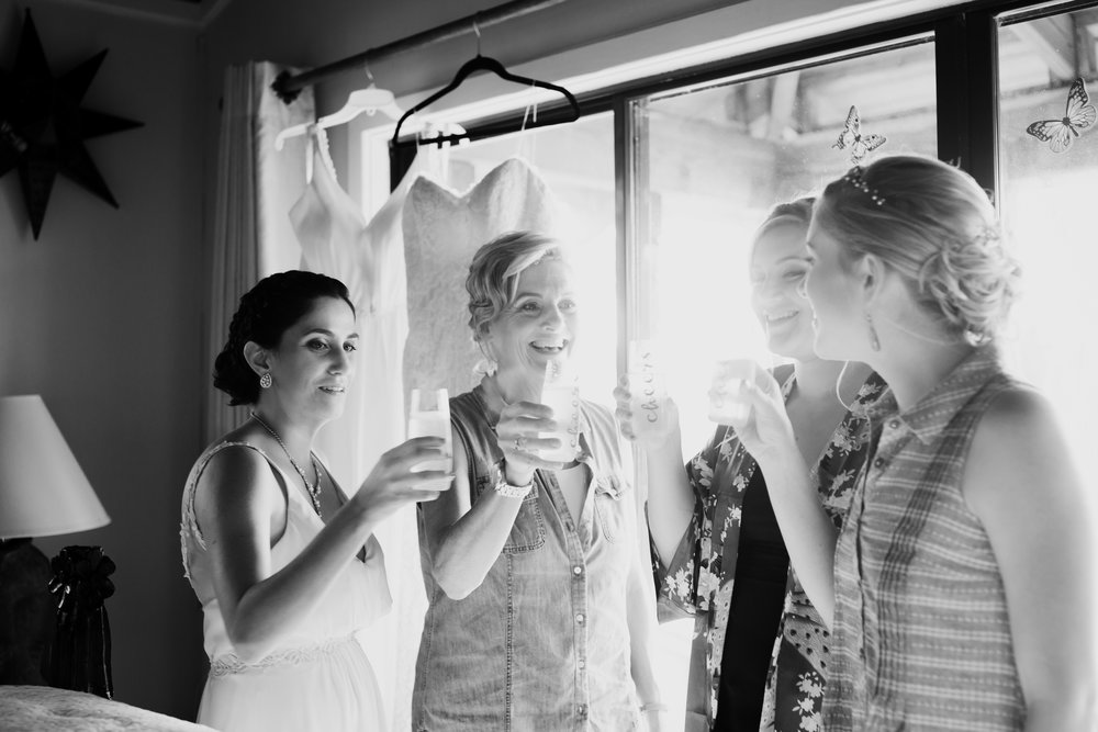 Wedding Party laughing anf toasting the bride on her wedding day at her destination in Puerto Rico