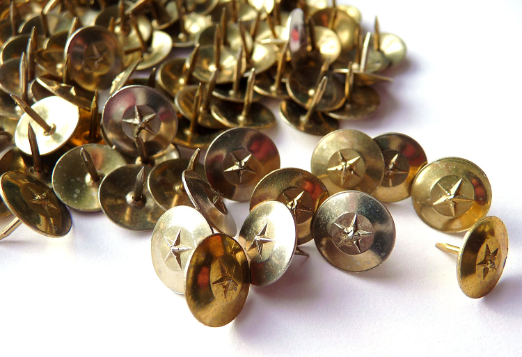 These are actual brass tacks.