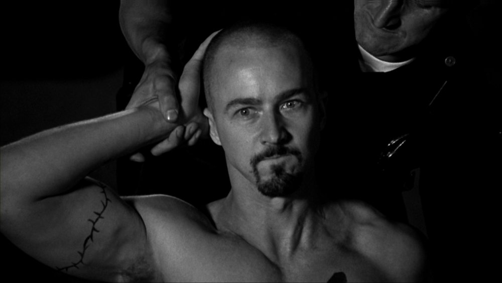 """Scene of the movie """"American History X"""". The white supremacist character played by E. Norton is arrested after having killed black thief he found in his house, following him in the street, shooting him, and then,while the thief was not a threat anymore neither for his property or for himself, decided to cruelly end his life."""