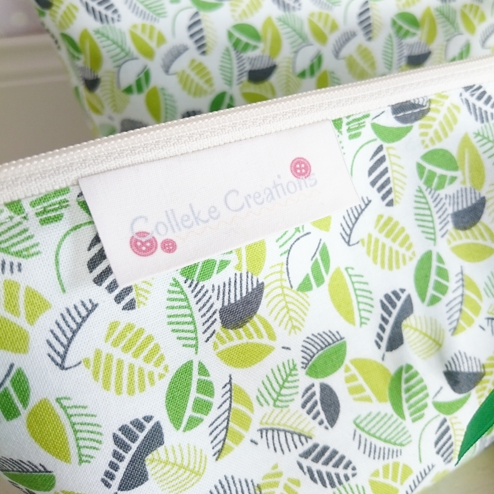 Boxed zipper pouches in green
