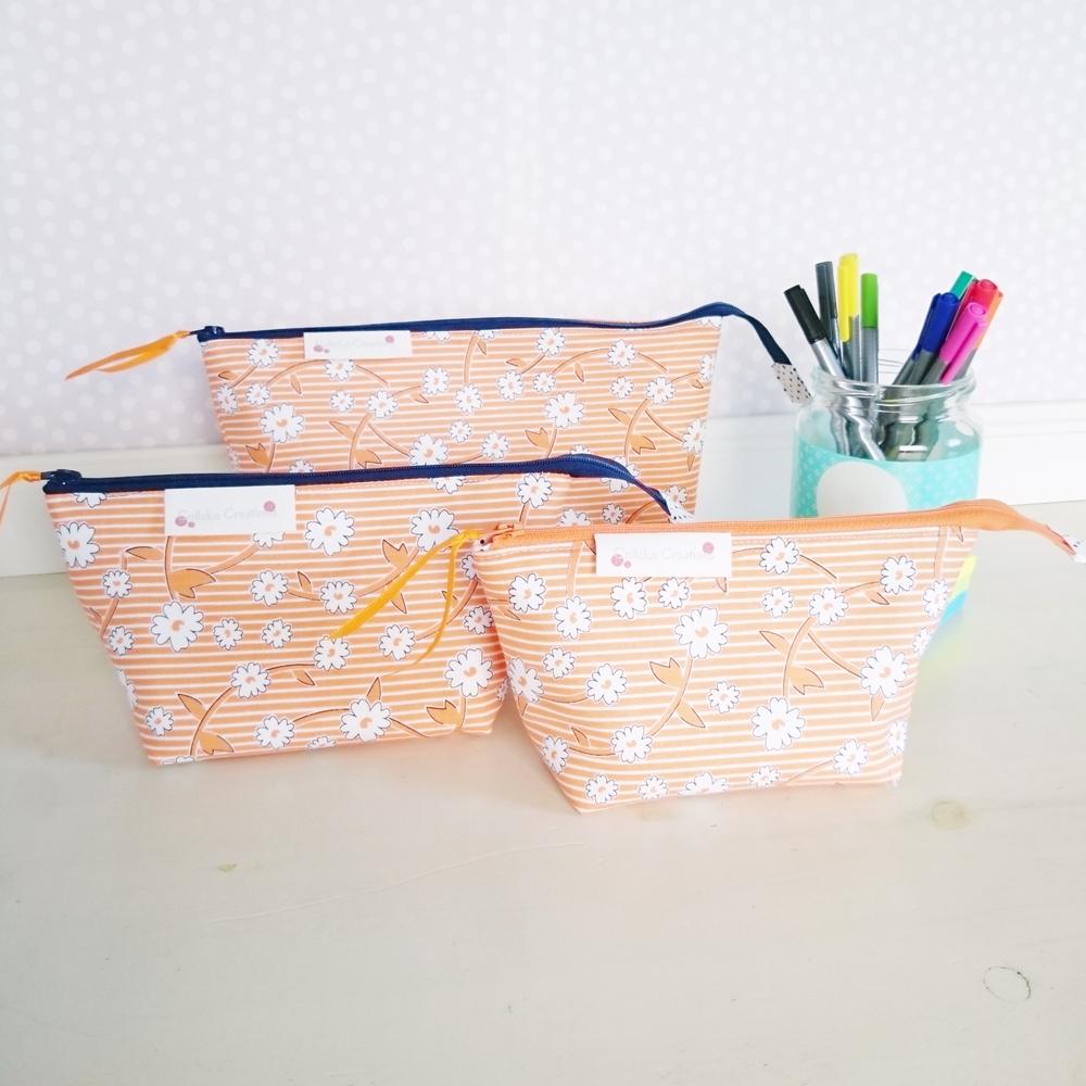 Boxed zipper pouches in orange