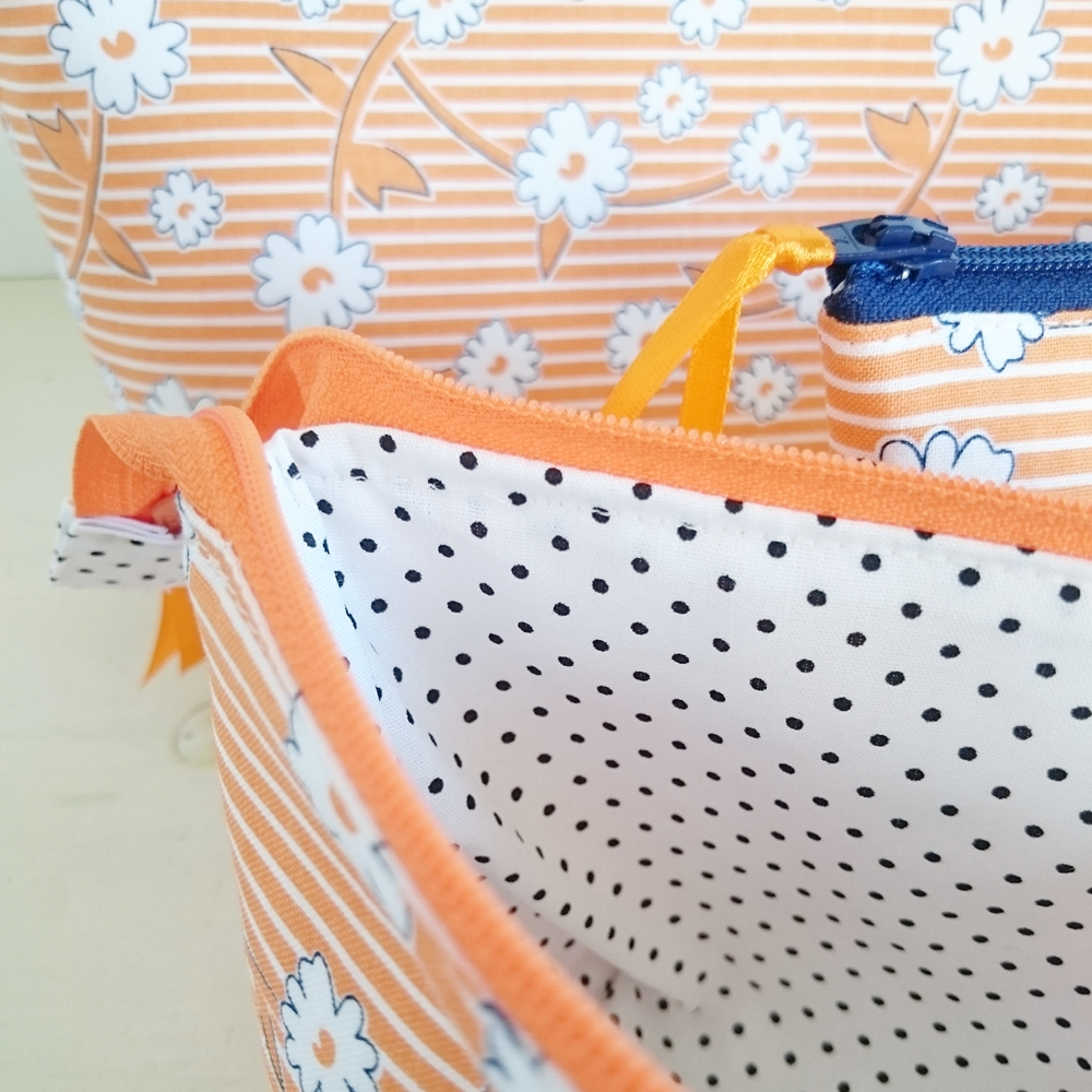 Boxed zipper pouches in orange