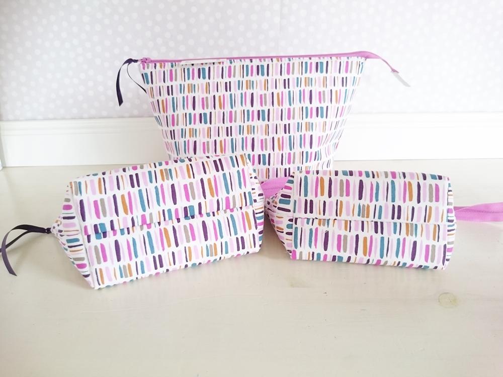 Boxed zipper pouches in purple