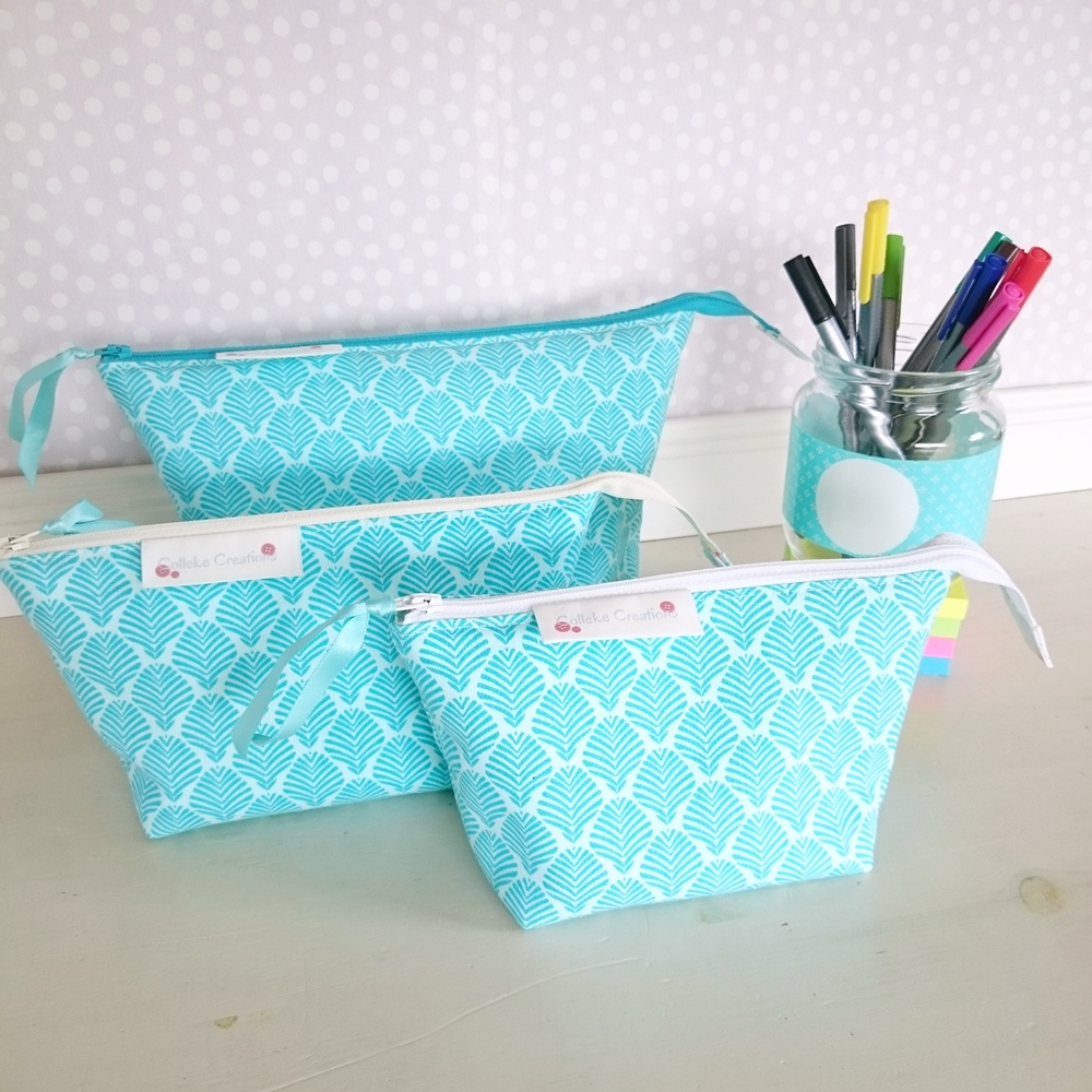 Boxed zipper pouches in turqoise